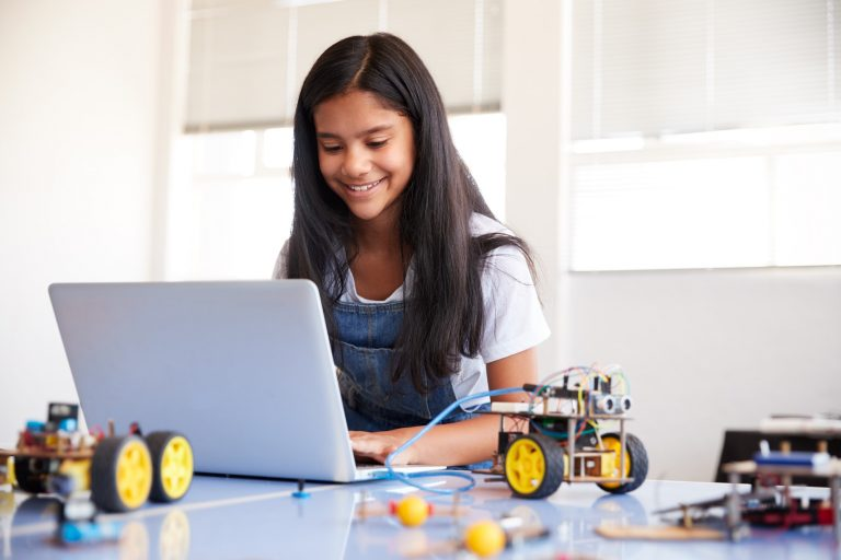 female-student-building-and-programing-robot-vehicle-in-after-school-computer-coding-class.jpg