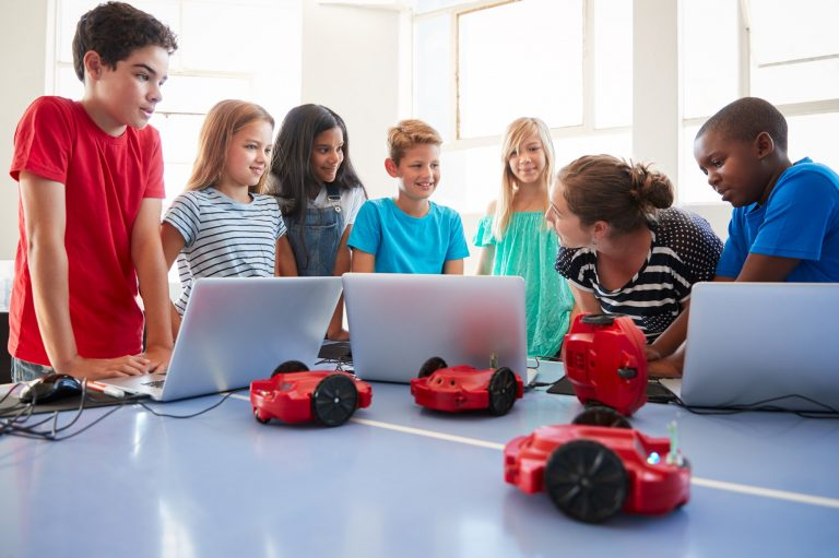 group-of-students-in-after-school-computer-coding-class-learning-to-program-robot-vehicle.jpg