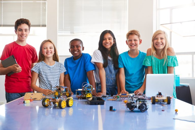 portrait-of-male-and-female-students-building-robot-vehicle-in-after-school-computer-coding-class-1.jpg