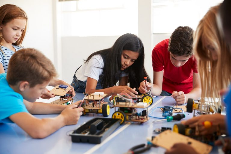 students-in-after-school-computer-coding-class-building-and-learning-to-program-robot-vehicle.jpg